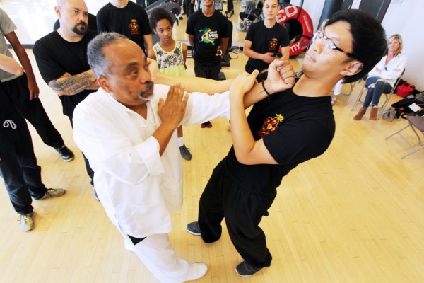 Sifu Julio comes in with a punch